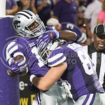 (Photo by Emily DeShazer | The Collegian)  K-State wide receiver Steven West and Zach Nemechek celebrate West's touchdown on August 30, 2014 at Bill Snyder Family Stadium.
