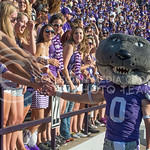 Photo by George Walker | The Collegian  Wille gives fans high-fives on Aug. 30, 2014 at Bill Snyder Family Stadium.