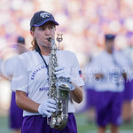 (Photo by Emily DeShazer | The Collegian)  A saxaphone player performs during the season opener on August 30, 2014 at Bill Snyder Family Stadium.