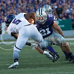 (Photo by Rodney Dimick | Collegian) Senior linebacker Jonathan Truman goes after  Stephen F. Austin wide receiver Justice Liggins on August 30, 2014 at Bill Snyder Family Stadium.