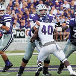 (Photo by Emily DeShazer | The Collegian)  Senior quarterback Jake Waters looks for open receivers down field as center B.J. Finney and offensive lineman Boston Stiverson blocks Stephen F. Austin's Collin Garrett on August 30, 2014 at Bill Snyder Family Stadium.