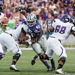 (Photo by Emily DeShazer | The Collegian)  Junior defensive end Marquel Bryant and a defensive lineman attempt to get around the Stephen F. Austin's blockers to get to their quarterback Zach Conque on August 30, 2014 at Bill Snyder Family Stadium.