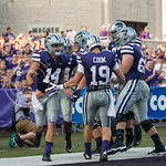 Photo by Rodney Dimick | The Collegian Senior wide receiver Curry Sexton claps hands with junior wide receiver Kody Cook after a touchdown on August 30, 2014 at Bill Snyder Family Stadium.