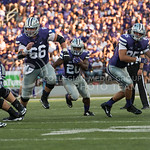 Photo by Rodney Dimick | The Collegian Senior running back DeMarcus Robinson carries the ball while his teammates create a path for him on August 30, 2014 at Bill Snyder Family Stadium.