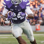 (Photo by Emily DeShazer | The Collegian)  Sophomore running back Charles Jones rushes downfield on August 30, 2014 at Bill Snyder Family Stadium.