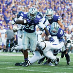 Photo by George Walker | The Collegian  Sophomore running back Charles Jones rushes away from defenders on Aug. 30, 2014 at Bill Snyder Family Stadium.