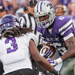 (Photo by Emily DeShazer | The Collegian)  Sophomore wide receiver Deante Burton looks to get around Stephen F. Austin's defensive back Keavon Madison on August 30, 2014 at Bill Snyder Family Stadium.