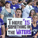 Photo by George Walker | The Collegian  A fan cheers on senior quarterback Jake Waters on Aug. 30, 2014 at Bill Snyder Family Stadium.