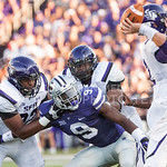 (Photo by Emily DeShazer | The Collegian)  Freshman linebacker Elijah Lee eyes the ball in the hands of Stephen F. Austin's quarterback Zach Conque on August 30, 2014 at Bill Snyder Family Stadium.