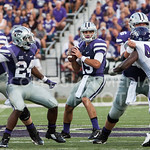 (Photo by Emily DeShazer | The Collegian)  Senior quarterback Jake Waters looks to pass as his offensive line protects him from Stephen F. Austin's defenders on August 30, 2014 at Bill Snyder Family Stadium.