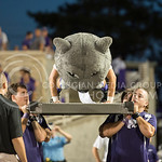 (Photo by Rodney Dimick | Collegian) Willie the Wildcat pumps out more pushups after K-State makes another touchdown on August 30, 2014 at Bill Snyder Family Stadium.