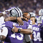 (Photo by Emily DeShazer | The Collegian)  Wide receiver coach Andre Coleman hugs sophomore wide receiver Steven West after West's touchdown on August 30, 2014 at Bill Snyder Family Stadium.