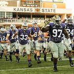 Photo by Rodney Dimick | The Collegian Players run onto the field before the game on August 30, 2014 at Bill Snyder Family Stadium.