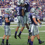 (Photo by Rodney Dimick | Collegian) Players get excited about a recent touchdown on August 30, 2014 at Bill Snyder Family Stadium.