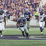 (Photo by Rodney Dimick | Collegian) Senior running back DeMarcus Robinson stays ahead while Stephen F. Austin players chase him on August 30, 2014 at Bill Snyder Family Stadium.