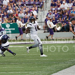 (Photo by Rodney Dimick | Collegian) Junior defensive back Morgan Burns tackles a Stephen F. Austin player on August 30, 2014 at Bill Snyder Family Stadium.