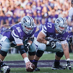 (Photo by Emily DeShazer | The Collegian)  K-State senior center B.J. Finney and junior offensive lineman Boston Stiverson line up on August 30, 2014 at Bill Snyder Family Stadium.