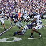 Photo by Rodney Dimick | The Collegian Senior linebacker Jonathan Truman rushes after the ball while his teammate tackles an opposing player on August 30, 2014 at Bill Snyder Family Stadium.