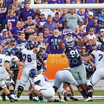 (Photo by Emily DeShazer | The Collegian)  Senior defensive tackle DeAndre Roberts stretches to try and block an extra point attempt by Stephen F. Austin's kicker Jordan Wiggs on August 30, 2014 at Bill Snyder Family Stadium.