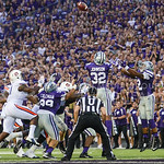 Parker Robb | The Collegian  K-State defenders jump to intercept a tipped Auburn pass during the second quarter of the Wildcats' 20-14 loss to Auburn Thursday evening in Bill Snyder Family Stadium. K-State stalled on their ensuing drive and ended up punting.