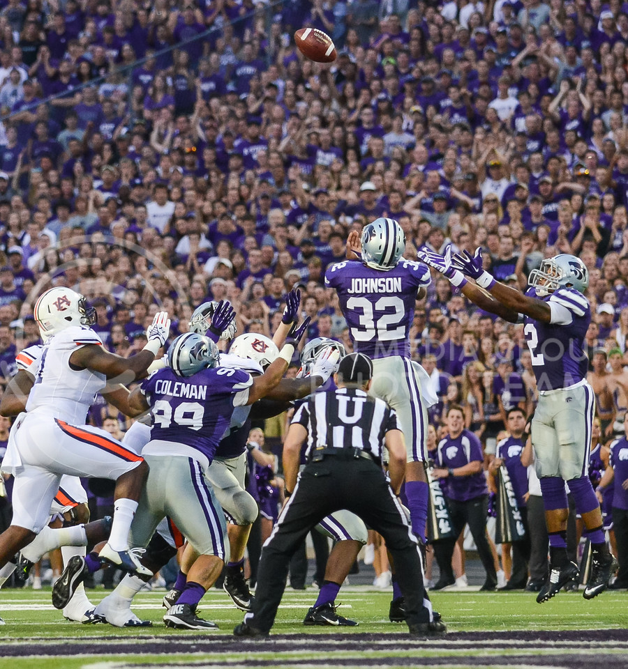 Parker Robb | The Collegian<br /> <br /> K-State defenders jump to intercept a tipped Auburn pass during the second quarter of the Wildcats' 20-14 loss to Auburn Thursday evening in Bill Snyder Family Stadium. K-State stalled on their ensuing drive and ended up punting.