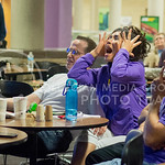 Alicia Egan, senior in modern languages, reacts to a missed pass during the football game against Auburn on Sept. 18, 2014. Many students gathered in the K-State Student Union to watch the game on the big screen. (George Walker | The Collegian)