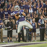 Junior defensive back Morgan Burns jumps to catch the ball on Sept. 18, 2014 at Bill Snyder Family Stadium.  (Rodney Dimick | The Collegian)