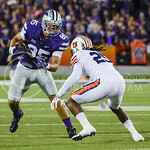 Parker Robb | The Collegian  Senior tight end Zach Trujillo attempts to dodge a tackle from Auburn defender Johnathan Ford during the Wildcats' 20-14 loss to Auburn Thursday evening in Bill Snyder Family Stadium.