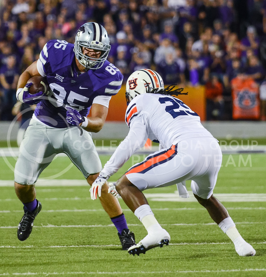 Parker Robb | The Collegian<br /> <br /> Senior tight end Zach Trujillo attempts to dodge a tackle from Auburn defender Johnathan Ford during the Wildcats' 20-14 loss to Auburn Thursday evening in Bill Snyder Family Stadium.
