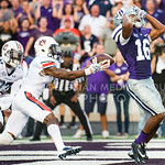 Auburn defensive back Jonathan Jones catches a tipped ball by K-State wide receiver Tyler Lockett in the endzone for an interception at Bill Snyder Family Stadium on Thursday, September 19, 2014.