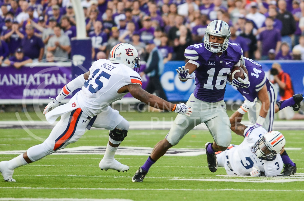 Parker Robb | The Collegian<br /> <br /> Senior wide receiver Tyler Lockett evades Auburn defender Joshua Holsey after making a catch during the first quarter of the Wildcats' 20-14 loss to Auburn Thursday evening in Bill Snyder Family Stadium.