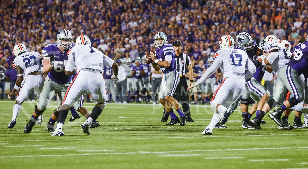 Parker Robb | The Collegian<br /> <br /> Senior quarterback Jake Waters looks downfield for an open receiver during the Wildcats' 20-14 loss to Auburn Thursday evening in Bill Snyder Family Stadium.