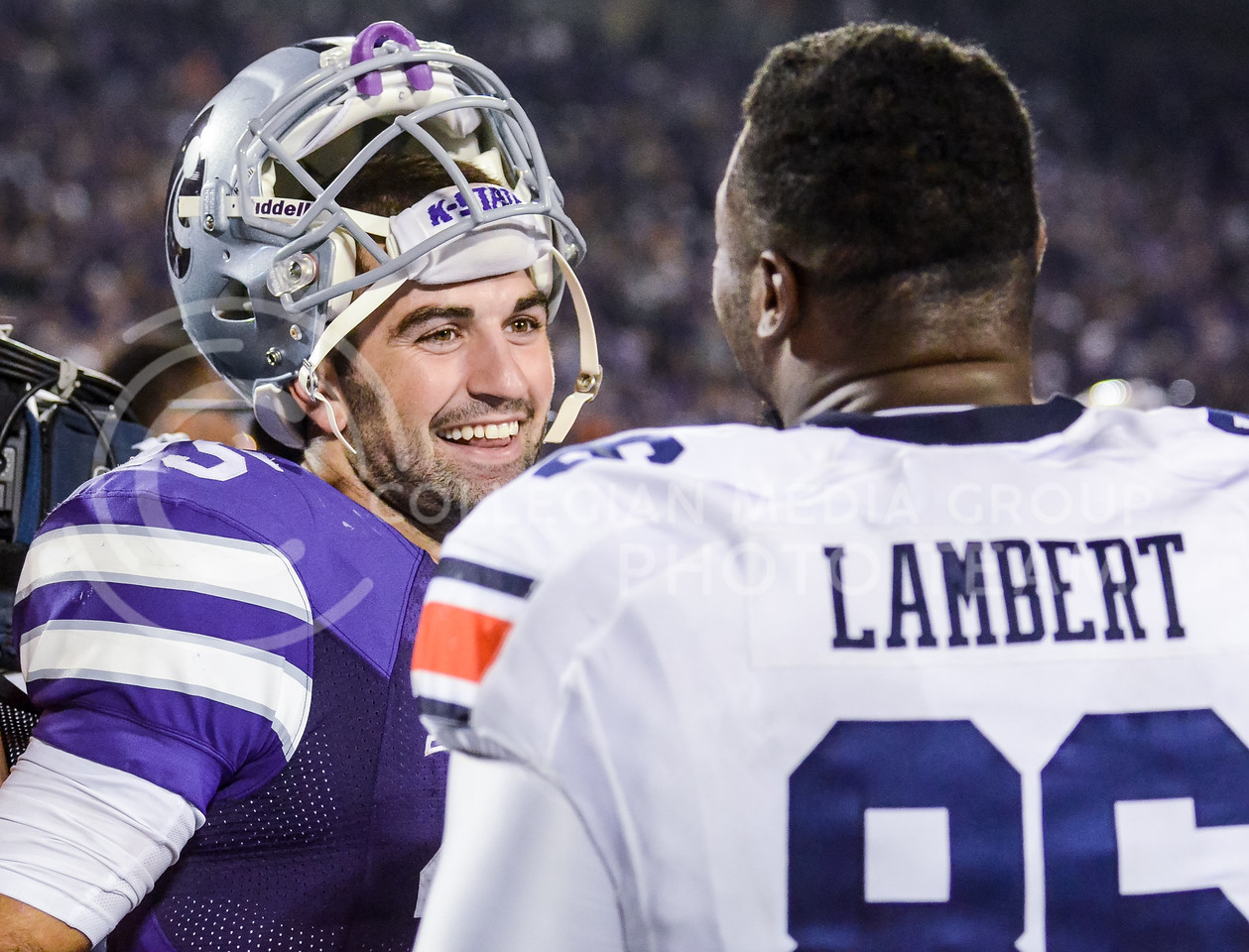 Parker Robb | The Collegian<br /> <br /> Senior quarterback Jake Waters chats with Auburn defensive end DaVonte Lambert following the Wildcats' 20-14 loss to Auburn Thursday evening at Bill Snyder Family Stadium.