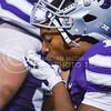 Parker Robb | The Collegian<br /> <br /> Senior wide receiver Tyler Lockett spits into his gloves to help him grip catches during the Wildcats' 20-14 loss to Auburn Thursday evening in Bill Snyder Family Stadium.