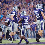 K-State's defense celebrates after an interception at Bill Snyder Family Stadium on Thursday, September 19, 2014.