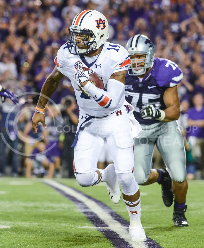 Parker Robb | The Collegian<br /> <br /> Auburn quarterback Nick Marshall rushes the ball during the Wildcats' 20-14 loss to Auburn Thursday evening in Bill Snyder Family Stadium.