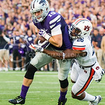 K-State wide receiver Kody Cook trys to out run the grasp of Auburn linebacker Justin Garrett at Bill Snyder Family Stadium on Thursday, September 19, 2014.