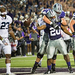 K-State running back DeMarcus Robinson celebrates a touchdown with offensive lineman Boston Stiverson at Bill Snyder Family Stadium on Thursday, September 19, 2014.