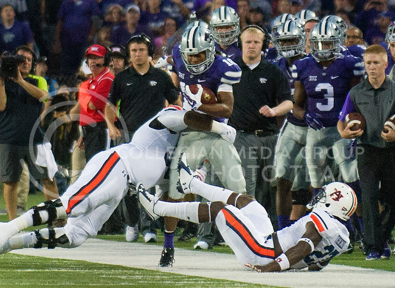 K-State wide receiver Tyler Lockett is pushed out of tackeled out of bounds at Bill Snyder Family Stadium on Thursday, September 19, 2014.
