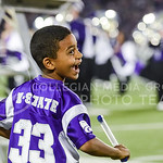 Parker Robb | The Collegian  A young K-State fan pretents to direct the K-State Marching Band from the sideline during halftime of the Wildcats' 20-14 loss to Auburn Thursday evening in Bill Snyder Family Stadium.