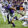 Parker Robb | The Collegian<br /> <br /> Senior wide receiver Curry Sexton evades several tackles, this one from Auburn defensive back Nick Ruffin en route to a big gain in yardage during the second quarter of the Wildcats' 20-14 loss to Auburn Thursday evening in Bill Snyder Family Stadium.
