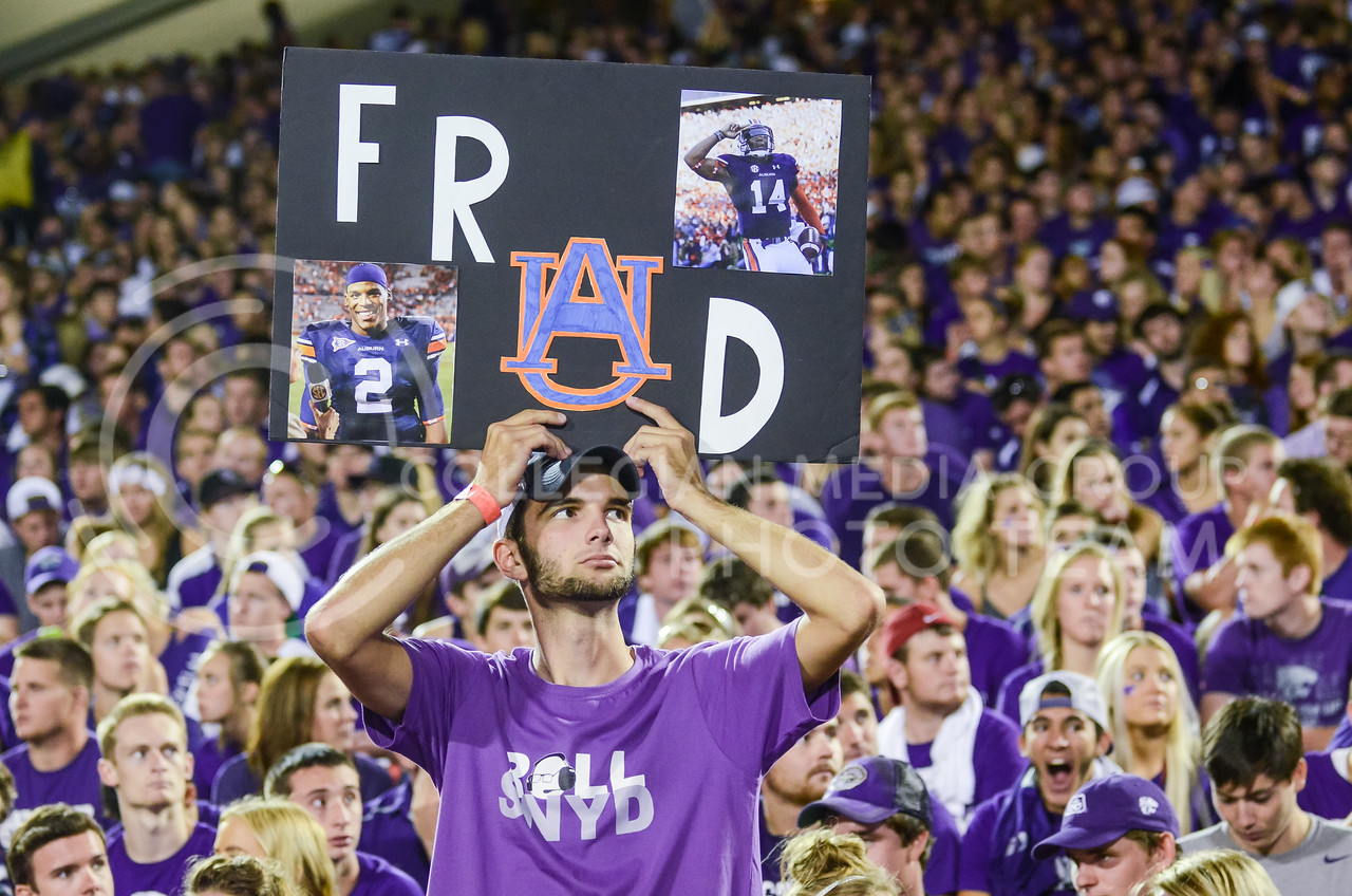 Parker Robb | The Collegian<br /> <br /> A K-State student holds a sign during the Wildcats' 20-14 loss to Auburn Thursday evening in Bill Snyder Family Stadium.