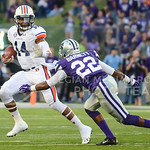 Parker Robb | The Collegian  Auburn quarterback Nick Marshall evades a tackle from junior safety Dante Barnett during the second quarter of the Wildcats' 20-14 loss to Auburn Thursday evening in Bill Snyder Family Stadium.