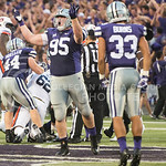 Junior defensive lineman Travis Britz pumps up the crowd on Sept. 18, 2014 at Bill Snyder Family Stadium.  (Rodney Dimick | The Collegian)