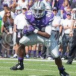 Sophomore running back Charles Jones takes the ball downfield during the game vs. UTEP on Sept. 27, 2014 in Bill Snyder Family Stadium. (George Walker | The Collegian)