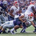 K-State defensive lineman Travis Britz sacks UTEP quarterback Jameill Showers on Saturday, September 27, 2014 at Bill Snyder Family Stadium.