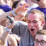 A fan makes the wildcat hand sign and cheers during the game vs. UTEP on Sept. 27, 2014 in Bill Snyder Family Stadium.  (George Walker | The Collegian)