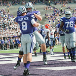 K-State back up quarterback Joe Hubener celebrates a touchdown with tight end Cody Small on Saturday, September 27, 2014 at Bill Snyder Family Stadium.