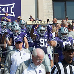 The KSU football team stepping onto the field during kick-off at the KSU vs. UTEP football game at Bill Synder Family Statium on September 27, 2014. (Cassandra Nguyen | The Collegian)