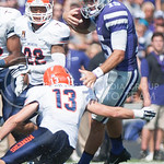 Senior quarterback Jake Waters attempts to avoid a tackle during the game vs. UTEP on Sept. 27, 2014 in Bill Snyder Family Stadium. (George Walker | The Collegian)